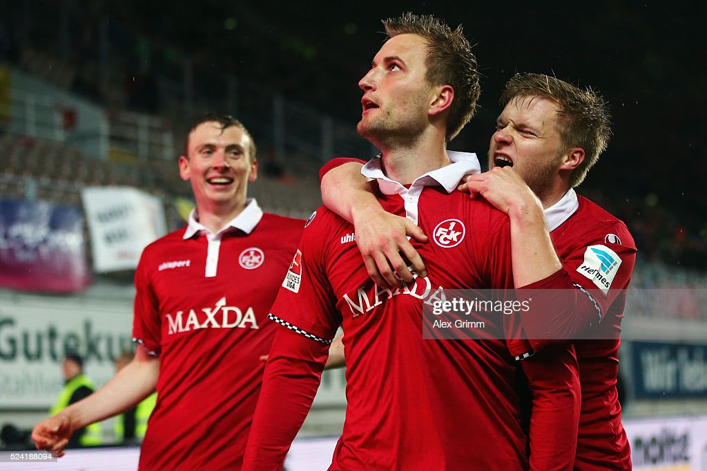 Kacper Przybylko of Kaiserslautern celebrates his team's first goal with team mates Jean Zimmer and Jon Dadi Bodvarsson during the Second Bundesliga match between 1. FC Kaiserslautern and RB Leipzig at Fritz-Walter-Stadion on April 25, 2016 in Kaiserslautern, Germany.