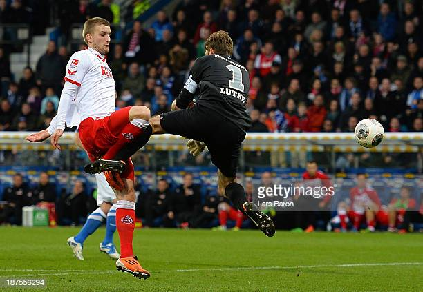 Kacper Przybylko of Koeln is challenged by goalkeeper Andreas Luthe of Bochum during the Second Bundesliga match between VfL Bochum and 1 FC Koeln at...