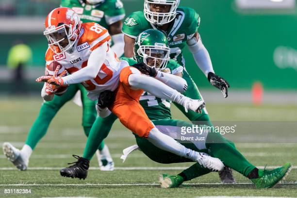 Kacy Rodgers II of the Saskatchewan Roughriders makes a tackle on Chris Williams of the BC Lions in the game between the BC Lions and the...