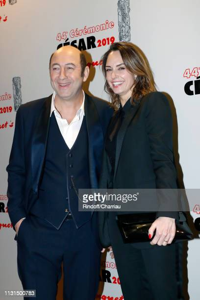 Kad Merad host and companion Julia Vignali attend 'Dinner at Le Fouquet's' during Cesar Film Award 2019 at Le Fouquet's on February 22 2019 in Paris...