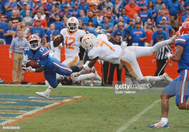 Kadarius Toney of the Florida Gators reaches for the football in front of Rashaan Gaulden of the Tennessee Volunteers during the second half of their...