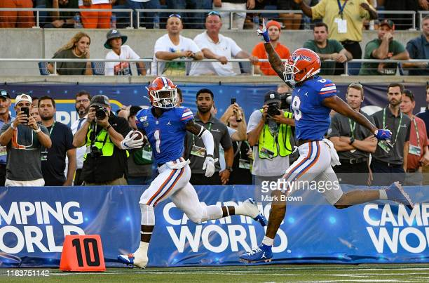 Kadarius Toney of the Florida Gators scores a touchdown in the first half against the Miami Hurricanes in the Camping World Kickoff at Camping World...