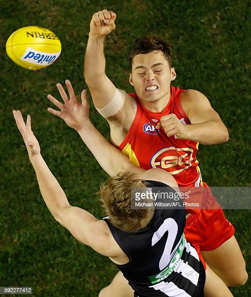 Kade Kolodjashnij of the Suns and Jordan De Goey of the Magpies compete for the ball during the 2016 AFL Round 22 match between the Collingwood...