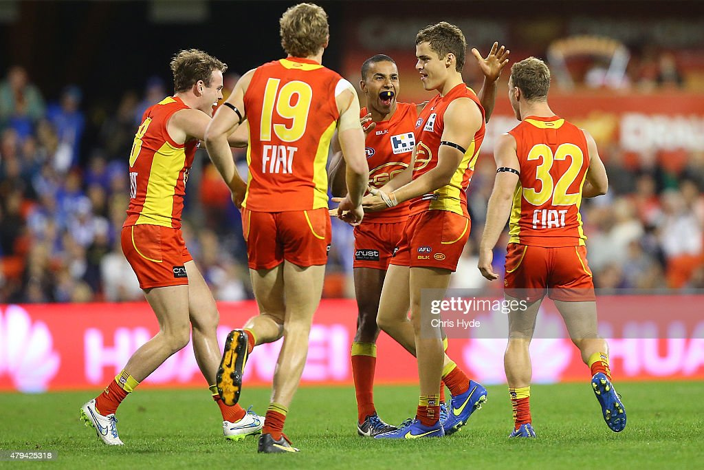 Kade Kolodjashnij of the Suns celebrates a goal during the round 14 AFL match between the Gold Coast Suns and the North Melbourne Kangaroos at Metricon Stadium on July 4, 2015 in Gold Coast, Australia.