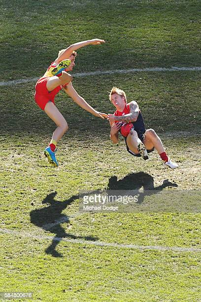Kade Kolodjashnij of the Suns collides into James Harmes of the Demons during the round 19 AFL match between the Melbourne Demons and the Gold Coast...