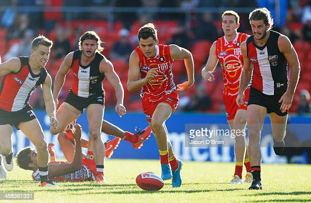 Kade Kolodjashnij of the suns in action during the round 15 AFL match between the Gold Coast Suns and the St Kilda Saints at Metricon Stadium on July...