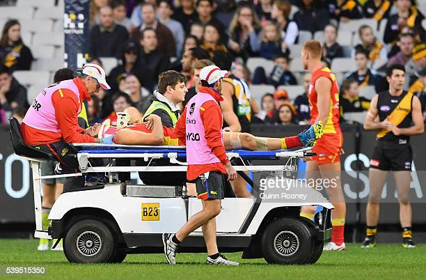 Kade Kolodjashnij of the Suns is taken off on a stretcher during the round 12 AFL match between the Richmond Tigers and the Gold Coast Suns at...
