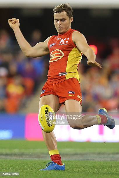 Kade Kolodjashnij of the Suns kicks during the round 16 AFL match between the Gold Coast Suns and the Brisbane Lions at Metricon Stadium on July 9...
