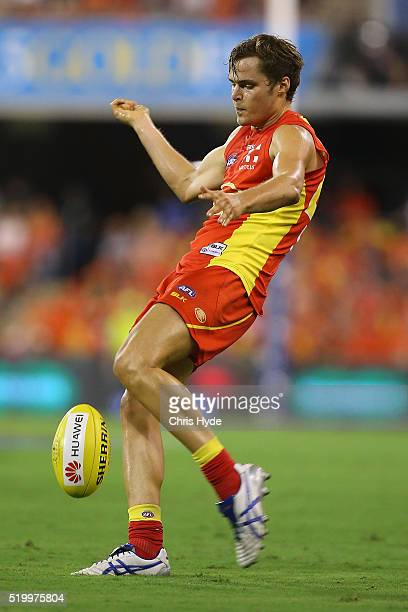 Kade Kolodjashnij of the Suns kicks during the round three AFL match between the Gold Coast Suns and the Carlton Blues at Metricon Stadium on April 9...
