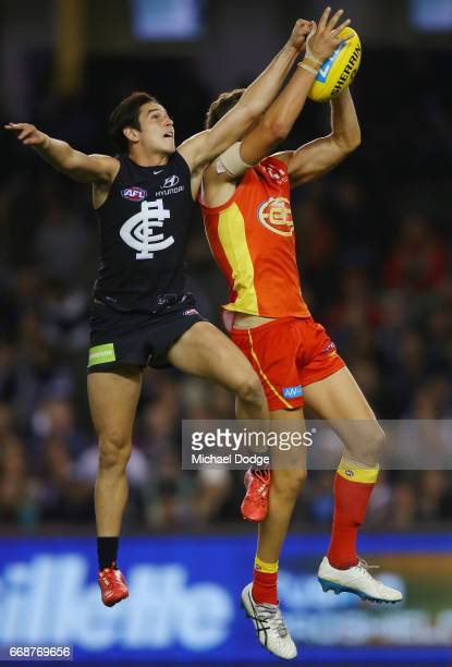 Kade Kolodjashnij of the Suns marks the ball against Zac Fisher of the Blues during the round four AFL match between the Carlton Blues and the Gold...