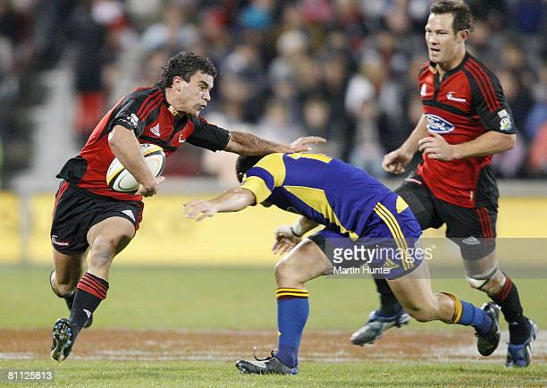 Kade Poki of the Crusaders is tackled by Mike Delany of the Highlanders during the round 14 Super 14 match between the Crusaders and the Highlanders...