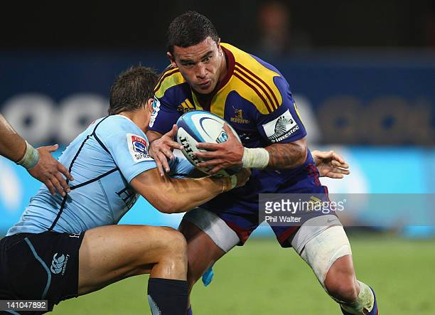 Kade Poki of the Highlanders is tackled during the round three Super Rugby match between the Highlanders and the Waratahs at Forsyth Barr Stadium on...