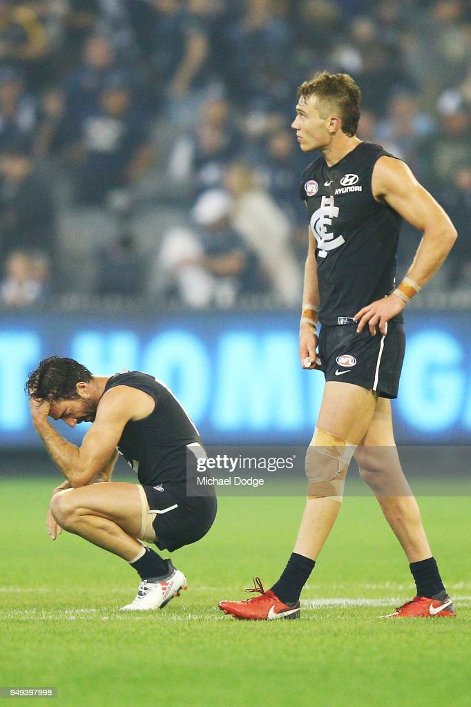 Kade Simpson (L) and Patrick Cripps of the Blues look dejected after defeat during the round five AFL match between the Carlton Blues and the West Coast Eagles at Melbourne Cricket Ground on April 21, 2018 in Melbourne, Australia.