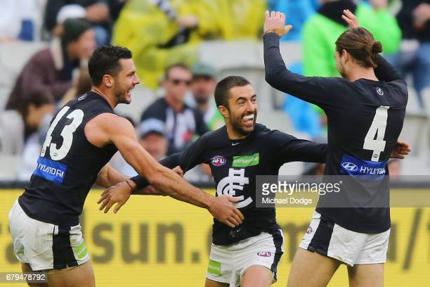 Kade Simpson of the Blues celebrates a goal with Simon White and Bryce Gibbs during the round seven AFL match between the Collingwood Magpies and the...