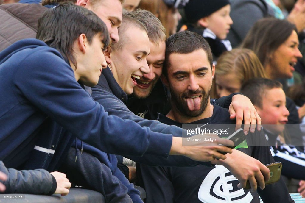 Kade Simpson of the Blues celebrates the win with fans during the round seven AFL match between the Collingwood Magpies and the Carlton Blues at Melbourne Cricket Ground on May 6, 2017 in Melbourne, Australia.