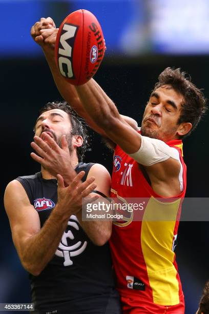 Kade Simpson of the Blues competes for the ball against Jack Martin of the Suns during the round 20 AFL match between the Carlton Blues and the GOld...
