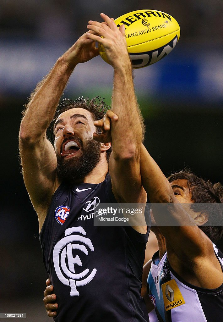 Kade Simpson of the Blues contests for the ball against Jake Neade of Port Adelaide during the round eight AFL match between the Carlton Blues and Port Adelaide Power at Etihad Stadium on May 19, 2013 in Melbourne, Australia.