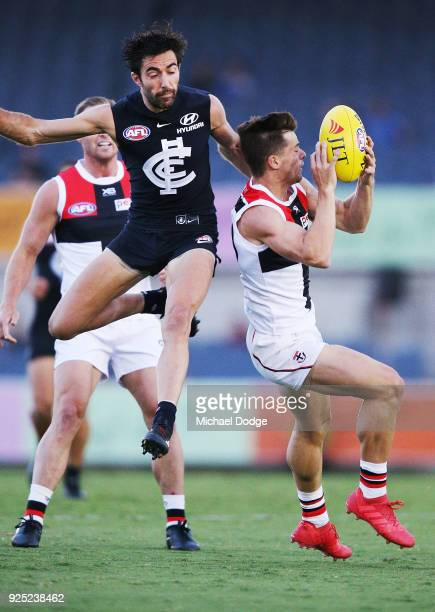 Kade Simpson of the Blues hits Jack Sinclair of the Saints late sparking a melee during the JLT Community Series AFL match between the Carlton Blues...