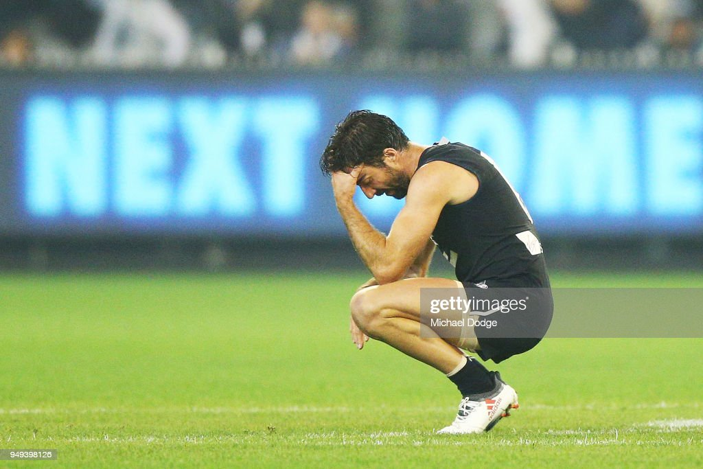Kade Simpson of the Blues looks dejected after defeat during the round five AFL match between the Carlton Blues and the West Coast Eagles at Melbourne Cricket Ground on April 21, 2018 in Melbourne, Australia.