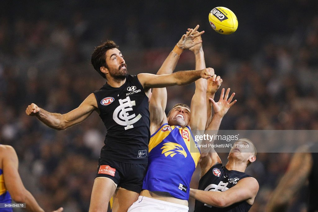 Kade Simpson of the Blues spoils the ball during the round five AFL match between the Carlton Blues and the West Coast Eagles at Melbourne Cricket Ground on April 21, 2018 in Melbourne, Australia.