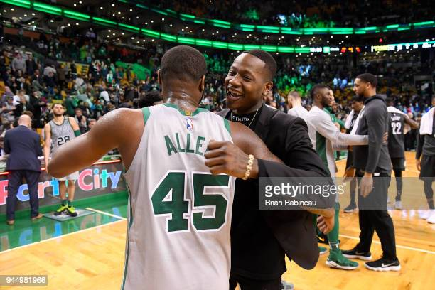 Kadeem Allen and Terry Rozier of the Boston Celtics hug after the game against the Brooklyn Nets on April 11 2018 at the TD Garden in Boston...