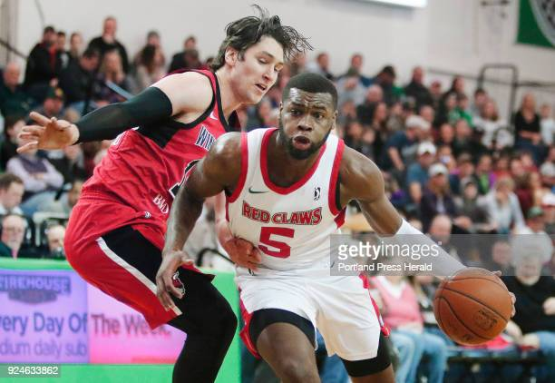 Kadeem Allen drives around Ryan Arcidiacono in first half Maine Red Claws vs Windy City Bulls action at the Portland Expo
