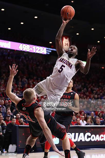 Kadeem Allen of the Arizona Wildcats attempts a shot over Tyler Rawson of the Utah Utes during the first half of the college basketball game at...