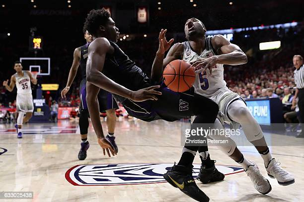 Kadeem Allen of the Arizona Wildcats collides into Noah Dickerson of the Washington Huskies as he drives to the basket during the first half of the...