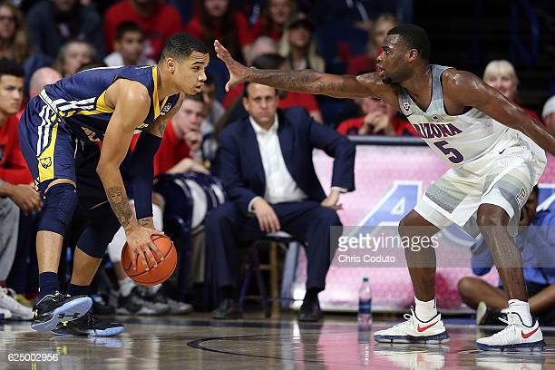 Kadeem Allen of the Arizona Wildcats defends Jordan Davis of the Northern Colorado Bears during the first half of the NCAA college basketball game at...