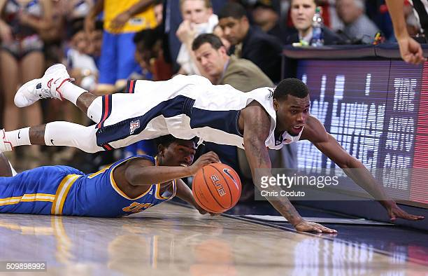 Kadeem Allen of the Arizona Wildcats dives over Isaac Hamilton of the UCLA Bruins during the second half of the college basketball game at McKale...