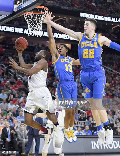 Kadeem Allen of the Arizona Wildcats drives to the basket against Ike Anigbogu and TJ Leaf of the UCLA Bruins during a semifinal game of the Pac12...