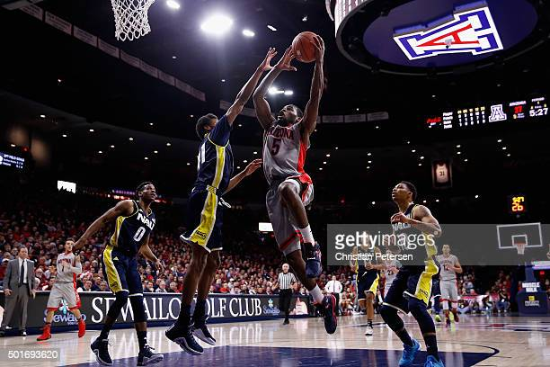 Kadeem Allen of the Arizona Wildcats drives to the basket against Marcus DeBerry of the Northern Arizona Lumberjacks during the first half of the...