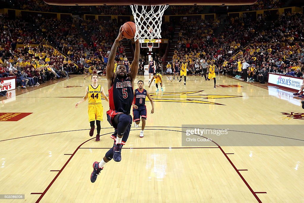 Kadeem Allen #5 of the Arizona Wildcats dunks during the second half of the college basketball game at Wells Fargo Arena on January 3, 2016 in Tempe, Arizona. The Arizona Wildcats beat the Arizona State Sun Devils 94-82.