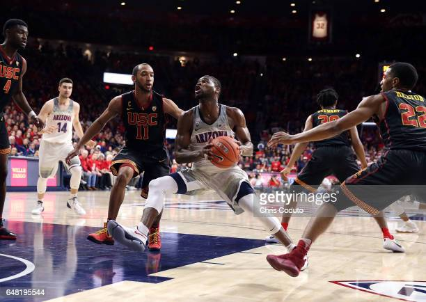 Kadeem Allen of the Arizona Wildcats is defended by Jordan McLaughlin of the USC Trojans and De'Anthony Melton during the second half of the college...