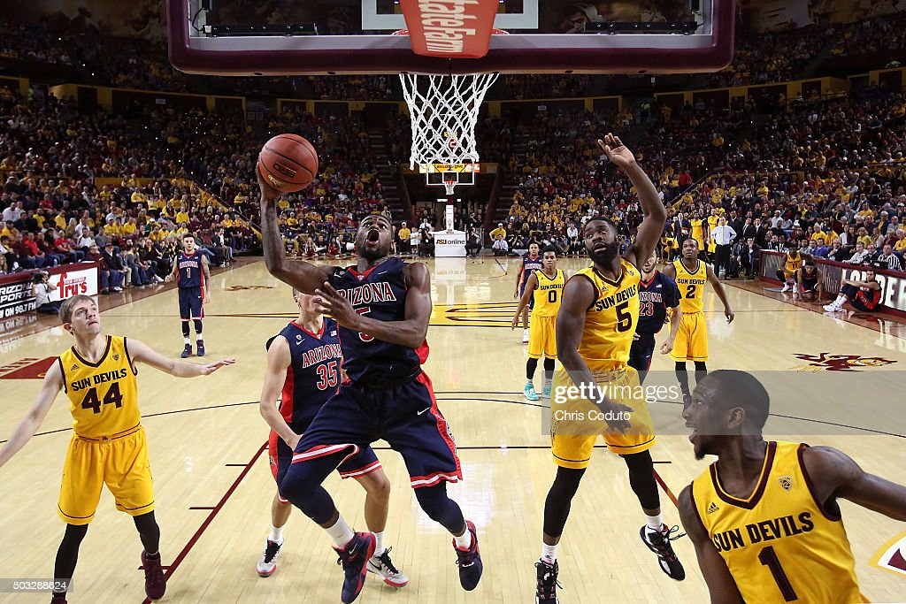 Kadeem Allen #5 of the Arizona Wildcats shoots over Obinna Oleka #5 of the Arizona State Sun Devils during the second half of the college basketball game at Wells Fargo Arena on January 3, 2016 in Tempe, Arizona. The Arizona Wildcats beat the Arizona State Sun Devils 94-82.