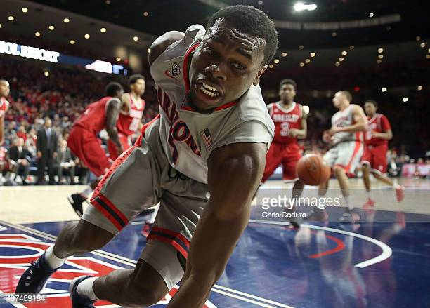 Kadeem Allen of the Arizona Wildcats stumbles after a first half layup during the college basketball game against the Bradley Braves at McKale Center...