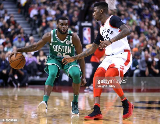 Kadeem Allen of the Boston Celtics dribbles the ball as Delon Wright of the Toronto Raptors defends during the second half of an NBA game at Air...