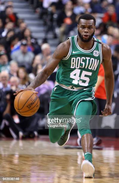 Kadeem Allen of the Boston Celtics dribbles the ball during the second half of an NBA game against the Toronto Raptors at Air Canada Centre on April...