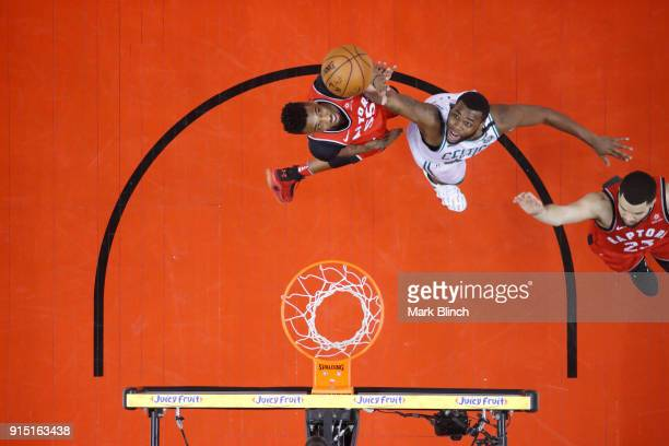 Kadeem Allen of the Boston Celtics goes up for a rebound against Delon Wright of the Toronto Raptors on February 6 2018 at the Air Canada Centre in...