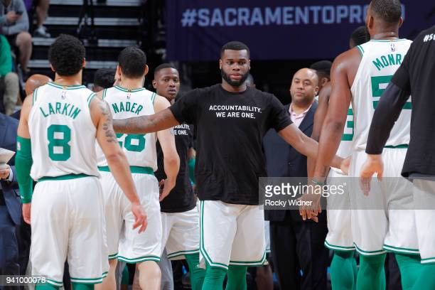 Kadeem Allen of the Boston Celtics high fives teammates during the game against the Sacramento Kings on March 25 2018 at Golden 1 Center in...