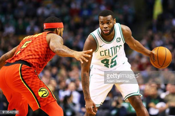 Kadeem Allen of the Boston Celtics is guarded by Malcolm Delaney of the Atlanta Hawks a game against the Atlanta Hawks at TD Garden on February 2...