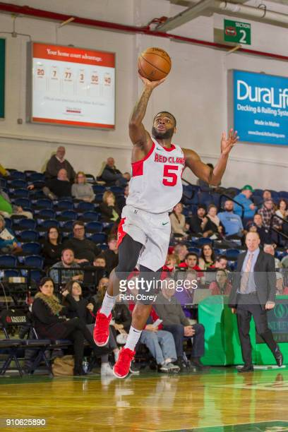 Kadeem Allen of the Maine Red Claws drives to the basket and shoots the ball against the Greensboro Swarm on January 25 2018 at the Portland Expo in...