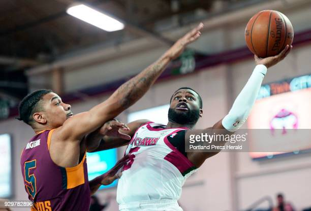 Kadeem Allen of the Red Claws drives past Arthur Edwards of Canton Thursday March 8 2018