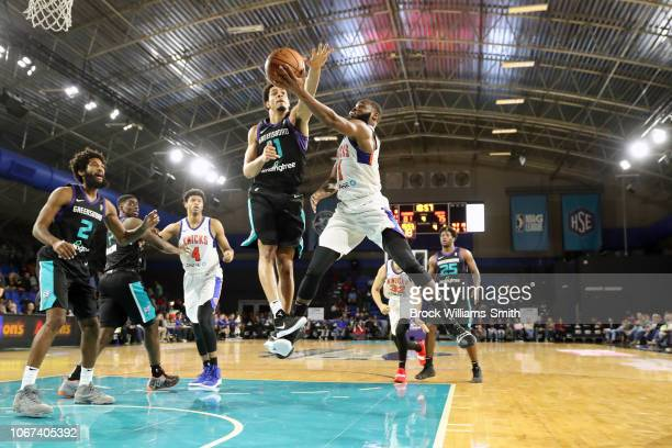 Kadeem Allen of the Westchester Knicks goes to the basket against the Greensboro Swarm during the NBA G-League on December 1, 2018 at the Greensboro...