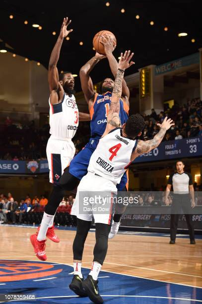 Kadeem Allen of the Westchester Knicks shoots against Chris Chiozza of and Isaiah Armwood of the Capital City Go Go at the Westchester County Center...
