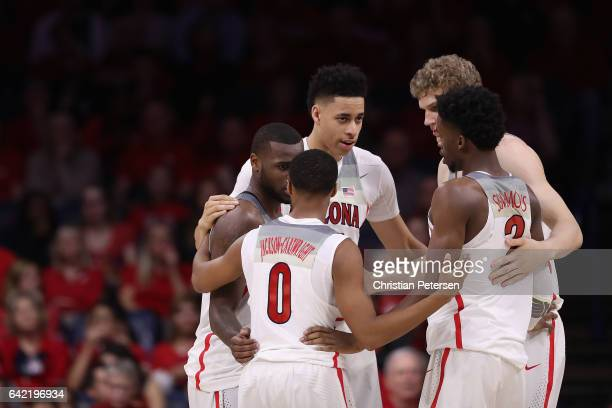 Kadeem Allen, Parker Jackson-Cartwright, Chance Comanche, Lauri Markkanen and Kobi Simmons of the Arizona Wildcats huddle up during the second half...