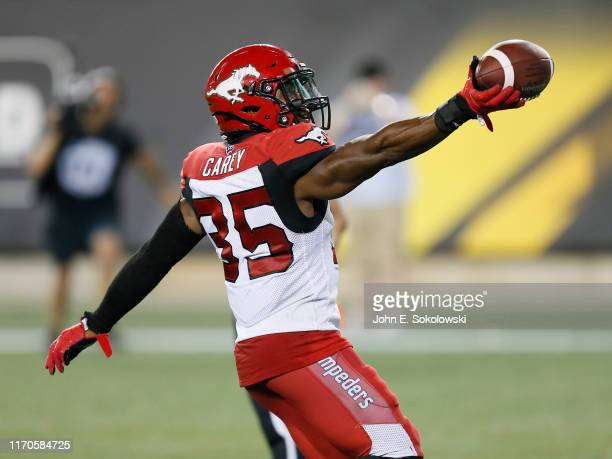 Ka'Deem Carey of the Calgary Stampeders taunts a Hamilton Tiger-Cats fan after scoring a touchdown at Tim Hortons Field on July 13, 2019 in Hamilton,...