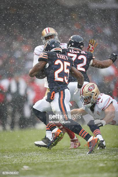 Ka'Deem Carey of the Chicago Bears eludes Nick Bellore of the San Francisco 49ers during the game at Soldier Field on December 4, 2016 in Chicago,...