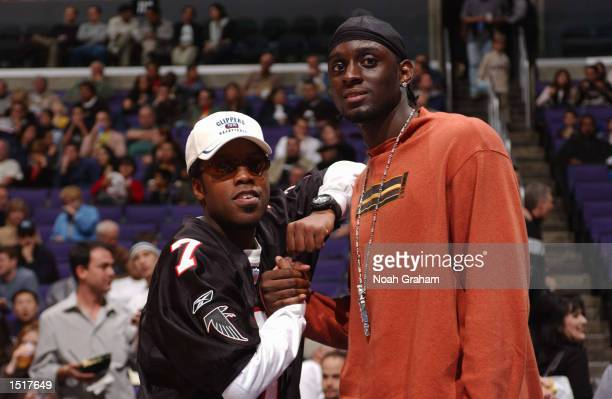 Kadeem Hardason and Darius Miles watches the Los Angeles Clippers take on the Milwaukee Bucks at Staples Center on October 23 2002 in Los Angeles...