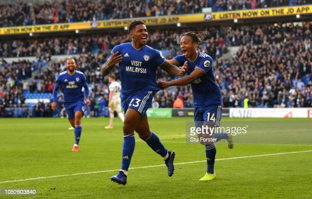Kadeem Harris of Cardiff City celebrates after scoring his team's fourth goal with Bobby Reid of Cardiff City during the Premier League match between...